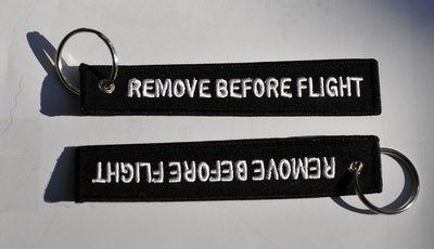 Remove before flight keychain (black color), key ring, luggage tag