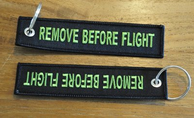 REMOVE BEFORE FLIGHT keychain keyring (black + green letters)