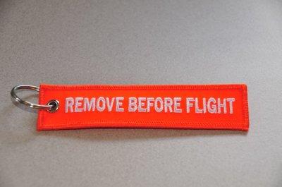 REMOVE BEFORE FLIGHT keychain keyring (orange + white letters)
